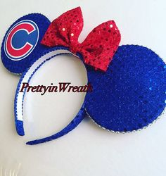 Chicago Cubs inspired Mickey Mouse ears headband. These ears are ideal for you Cubs fans to wear to Disney parks or to Wrigley Field. Ears are durable and will not flop. They are intended for adults but will fit some children. If you have any questions please message me.  Thank you, Made by PrettyinWreath