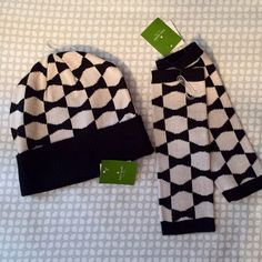 Kate spade matching winter hat and gloves Gorgeous winter hat and fingerless gloves with thumb holes! Black and offwhite. Mostly I live in a climate where I need more heavy duty winter wear! New with tags, never been worn. Perfect condition. kate spade Accessories Hats