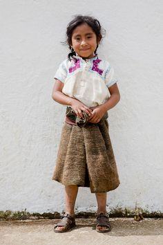Young girl in traditional dress. San Juan Chamula, Mexico. Tom Robinson Photography