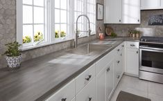 Get the look of wood without the maintenance. This laminate countertop features Formica's Umbra Oak paired with VT Industries' pencil-line Ora edge. Kitchen Redo, Home Decor Kitchen, Interior Design Kitchen, New Kitchen, Kitchen Remodel, Kitchen Ideas, Formica Laminate Countertops, Marble Countertops, Countertop Materials