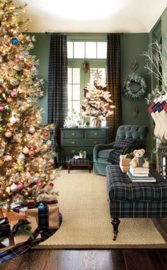 Living Room with a Christmas Tree and tartan curtain panels with matching chair and ottoman, via @sarahsarna.