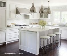 At Home in Arkansas - Classic kitchen with floor to ceiling Ikea white kitchen cabinets, ....