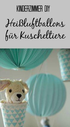 Gute Reise, Kuscheltiere! Diese Heißluftballons im Mini-Format sind nicht nur eine hübsche Deko für's Kinderzimmer, sondern auch ruckzuck zusammengebastelt.