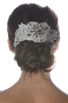 A low chignon bun accessorized with a jeweled headpiece by Elle & Jae. (Photo: Robert Mitra)