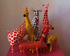 Paper mache polka doted animals.