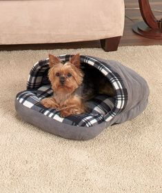Pets love chewing on slippers. Now you can redirect your dog or cat's interest with this Plaid Slipper Pet Bed that's their very own. It's partially closed for extra warmth and an added sense of security. It will quickly become your pet's favorite spot