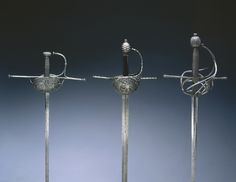 Rapier, c. 1650 Spain, 17th century steel, pierced and chiseled, leather and wood grip, Diameter: w. 13.00 cm (5 1/16 inches); Overall: l. 105.60 cm (41 9/16 inches); Blade: l. 99.50 cm (39 1/8 inches); Quillions: w. 29.60 cm (11 5/8 inches).