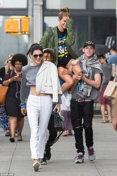 Friendly boost: Hailey Baldwin was given a lift by Jaden Smith and their pal Harry Hudson as she hit New York with best pal Kendall Jenner on Tuesday