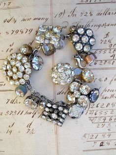 Vintage Rhinestone Button Bracelet Number 42 I keep making these and they keep selling so it's kind of a no-brainer...MAKE SOME MORE!   This bracelet has all vintage rhinestone buttons. There are so many different varieties and sizes, some with lacy bezels, some with clean setting and no prongs, some with gold tone settings, most with silver, all with various signs of age (which we love!)!...