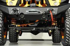 2014 Jeep Wrangler Unlimited in Lamborghini Arancio Borealis Exterior: Custom Lift Kit