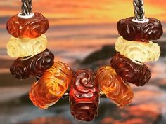 Stunning carved Amber roses! We will have over 40 of these beauties at the Trollbeads at the Beach festival October 14-16, 2016!