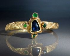 A popular style of Gothic ring, appearing in the 13th century and continuing into the 14th, the circular hoop finely decorated at the shoulders with three incis