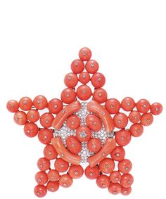 Coral brooch made by Diana Vreeland from her mother's beads, I need to do this with some of my Mom's pieces.  k