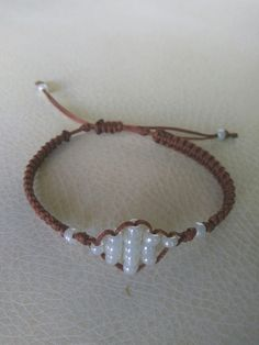 Brown macrame bracelet with white beads