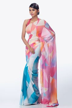 A light turquoise kaleidoscopic saree with bright pink palla, comes with a pink crepe-de-chine blouse piece.