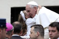Girl hugs Pope Francis after weekly audience in St. Peters Square at Vatican  A girl hugs Pope Francis after his weekly audience in St. Peters Square at the Vatican May 15. (CNS photo/Alessandro Bianchi, Reuters)