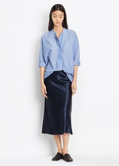 How stylish looks satin dark blue midi skirt with blue shirt. This outfit is a simple and cool and you can wear it every day. Street style in city this spring and summer Casual Chic, Skirt Fashion, Fashion Outfits, Women's Fashion, Slow Fashion, Fashion Trends, Top Street Style, Slip Skirts, Midi Skirts