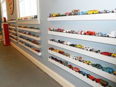 LOVE These shelves but would these cars every really stay on those shelves? Hmmm. ...via houzz.com modern kids by Lacey Carroll Interiors llc