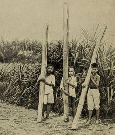 Filipino Boys Carrying water (in Bamboo poles) 1912 Bataan Death March, Filipino Culture, Filipiniana, Mindanao, Chiaroscuro, Cebu, Pinoy, World History, Vintage Pictures