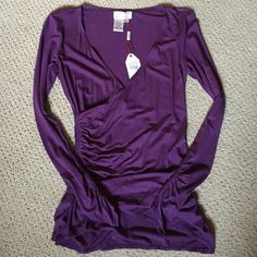 Max Studio purple wrap top Brand new faux wrap top with touching at waist and wrists. Flattering cut and a beautiful purple color. Viscose/spandex. Max Studio Tops