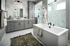 Master bathroom with marble walk in shower gray vanity and freestanding tub Large Bathrooms, Bathroom Design Small, Bathroom Designs, Shower Doors, Shower Tub, Aspen, Denver, Shower Installation, Gray Vanity
