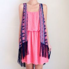 | new | floral fringe vest offers welcome new with tag size large navy fringe vest with pink floral print. can also fit a medium. •790518•  website: xomandysue.com instagram: xomandysue Tops Blouses