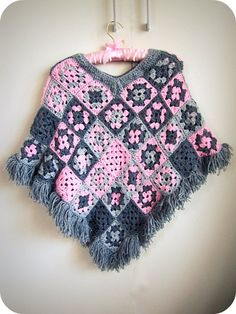 Crochet wool knitted poncho for ladies Poncho is an outer wear garment that keeps body warm and comfy in cool days and typically designed with a slit in the middle for the head. Crochet Wool, Crochet Shawl, Free Crochet, Crochet Granny, Crochet Poncho Patterns, Knitted Poncho, Granny Square Poncho, Granny Squares, Ladies Poncho
