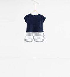 Image 1 de Robe en matières assorties de Zara