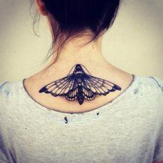 Moth tattoo on the upper back | TattooXd
