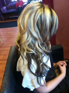 Blonde hair with brown lows and a teased crown. Loose curls and party ready! Get your hair done by @Kasey Collins Collins O'Hara at The Hair After in Westminster, MD. (410) 848-6234 located at 211 E Main St # 1 Westminster, MD 21157