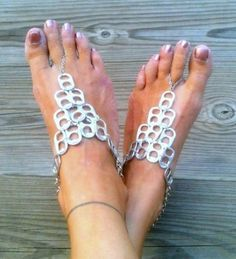 Recycled pop tab barefoot sandals. After drinking soda from aluminum cans, you can recycle your soda cans to create interesting projects instead of tossing the empty cans into the garbage or recycling bin.