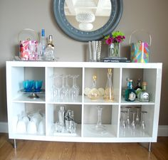 Possibly too many cubicle pieces if we also make a bar out of one. But this would be sooooo cute! Could hang racks on the top of some cubes to hang glasses. Great way to display all our awesome stemware. Should line shelves with something cute but sophisticated. Also, could organize cubbies in type of alcohol.