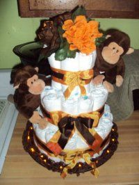 Monkey Around Diaper Cake: Monkey Around Diaper Cake  The pamper cake was made with about 55 swaddle pampers size 1, rubber bands, lace, decorated 2in. and 1 and a half in. ribbon,