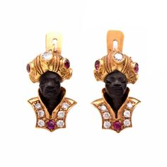 These vintage Blackamoor earrings are full of character, exquisite details and fine sparkle. Finely crafted in solid 18K yellow gold, these earrings feature a figure, with attire that is accented with 14 genuine round cut diamonds approx. 0.30 ct, F-G  color, VS clarity and 10 genuine round cut rubies approx. 0.30 ct. These vintage highly collectible earrings are rendered in wonderful detail, made for pierced ears and remain in excellent condition!! Weight is approx: 6.0 Grams Width/Height…