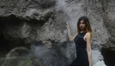Fine art. smoke.  Photography.  Model. Location shoot. Dark. Grey.