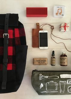 Travel Tip: for a long holiday weekend, a large backpack filled with the essentials is all you need, including Happy Plugs headphones, Damn Handsome grooming supplies and a tan leather phone case by PAP Sweden | Banana Republic