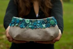 Button Clutch - such a cool an inexpensive way to repurpose an old purse or a purse from a thrift store!