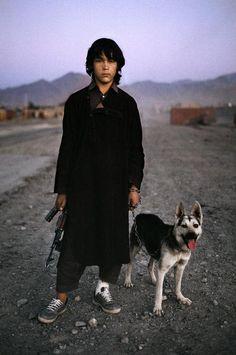 "Steve McCurry AFGHANISTAN. 1992. Afghan boy waits for a ride on the road to Kandahar. """