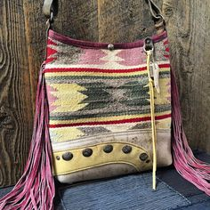 Fringed Navajo bucket with vintage leather base and stamped sterling conchos