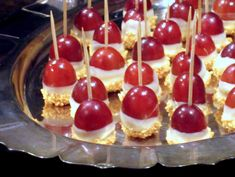 PINNER SAID: Need a quick and easy party appetizer? Use a toothpick to dip big, red grapes halfway into melted white chocolate. Then dip the bottom in crushed nuts (peanuts, cashews, whatever you have). Done, that's it. They taste just like caramel apples. Make a ton because they disappear quickly!