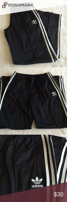 Adidas Firebird Track Pants Adidas Firebird Track pants in classic black with white stripes.  These have the soft sheen of tricot fabric and a loose fit.   They have zippered pockets as well as zippers at each ankle.  In excellent like new condition.  Worn once. Adidas Pants Track Pants & Joggers