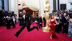 SPRING IN HIS STEP: Bret McKenzie, who won an Oscar on Monday for Man or Muppet on the red carpet before the ceremony. Bret's wife, Hannah Clarke, is at far right, behind actress Jane Seymour.