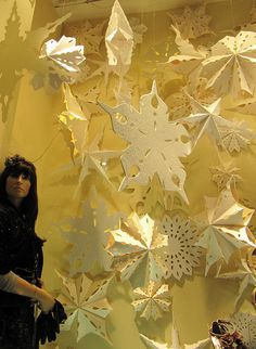 I would do it a bit different-Handmade snowflakes, painted different shades of whites and ice blues, and different sizes.