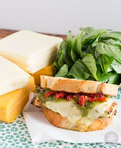 Turn on the grill & whip up this cheesy pesto chicken sandwich made with LAND O LAKES® Sharp Cheddar American Blend!