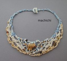 Dali's Elephant necklace by machichi. Beautiful freeform peyote stitched necklace. The combination of sand beige and soft turquoise evokes thoughts if the sea. I'd prefer a starfish of seahorse instead of an elephant.