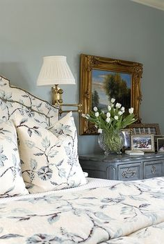 Matching floral bedding and headboard in the bedroom.