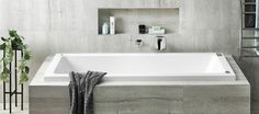Tiling a ledge around an inset bath allows plenty of room for soap and shampoo (or the kids' collection of bath toys!).