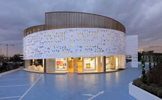 Placebo Pharmacy by Klab Architecture.  Metal panels are perforated with Braille!