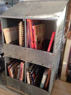 A vintage chicken nesting box now repurposed to hold and organize my books!