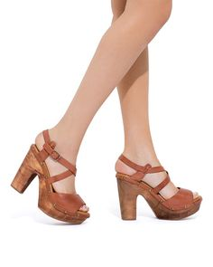 Start planning for summer with these strappy wooden platform sandals